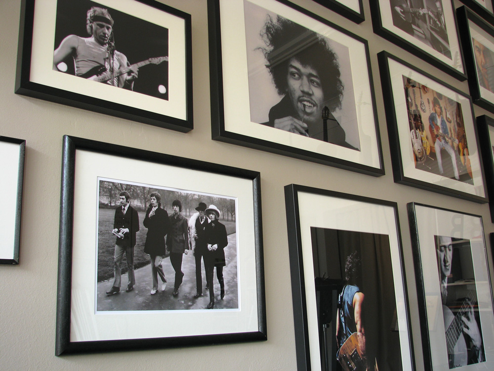 the big b, guitar tuition, wall of guitarist photos